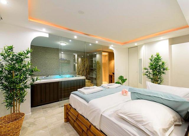 dormir dans une chambre avec jacuzzi privatif à Toulouse au Sablotin spa